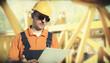 worker in protective uniform and protective helmet