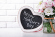 Frame and flowers for mother's day on brick wall background