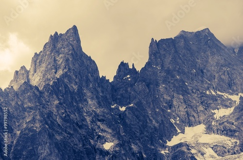 Fotobehang Bergen Cloudy Alp Mountains