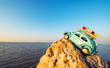 toy retro car on rock by the sea