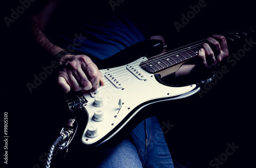 Photo  Young man playing electric guitar