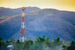 Leinwanddruck Bild - Telecommunication tower on the field