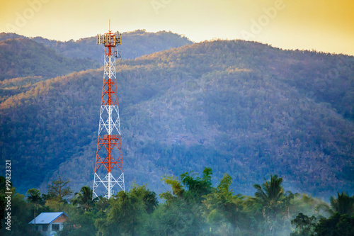 Telecommunication tower on the field