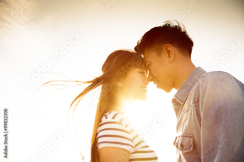 Valokuvatapetti Smiling Couple in love with sunlight background