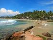Mirissa bay with rocks, greens and ocean waves, Sri Lanka
