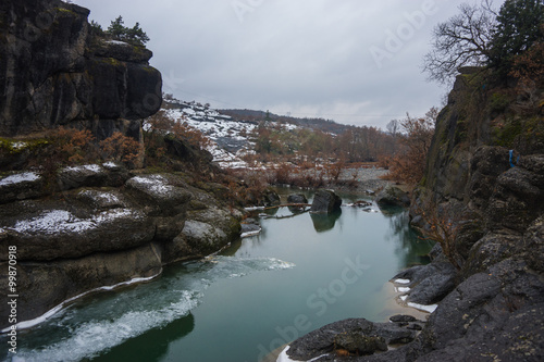Canvas Prints Cappuccino River with green waters, snow and ice near Meteora in Greece