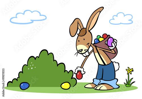 Cartoon Osterhase beim Ostereier verstecken - 99878133