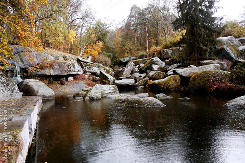Keuken foto achterwand Bruggen Lake with stoned shores in the autumn park
