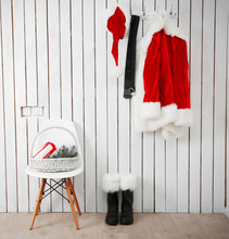 Santa Red Suit On A Wooden White Wall