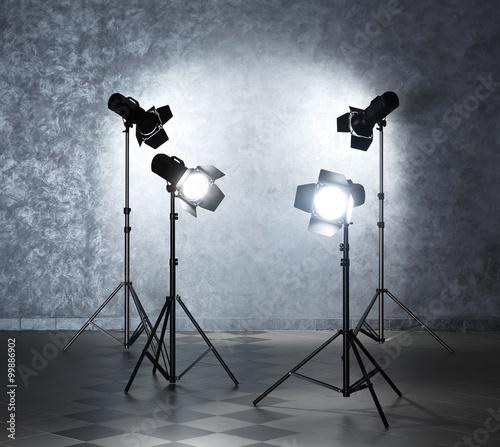 Foto op Canvas Licht, schaduw Lighting equipment on grey wall