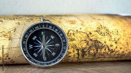 Close up compass on vintage map. Retro style. Wallpaper Mural
