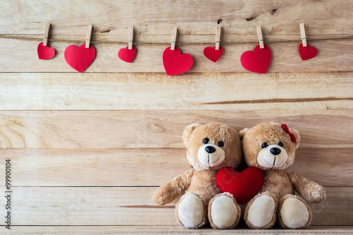 The couple Teddy bear holding a heart-shaped pillow Fototapeta