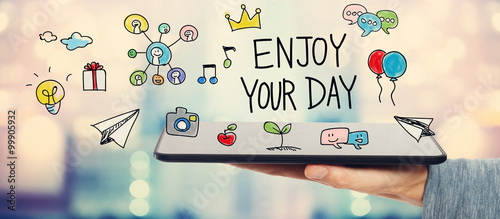 Photo  Enjoy Your Day concept with man holding a tablet