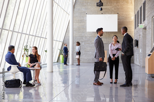 Fotografija Interior Of Busy Office Foyer Area With Businesspeople
