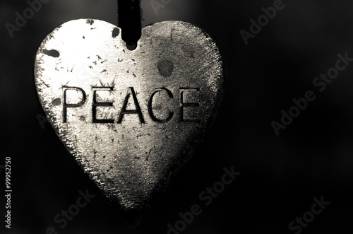 Metal Heart Shaped Peace Medallion Poster