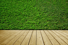 Green Leaves Wall Background And Brown Wooden Floor.
