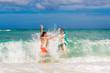 Happy couple having fun on the beach of a tropical island. Summe