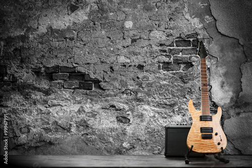 Obraz Electric guitar on a brick wall background - fototapety do salonu