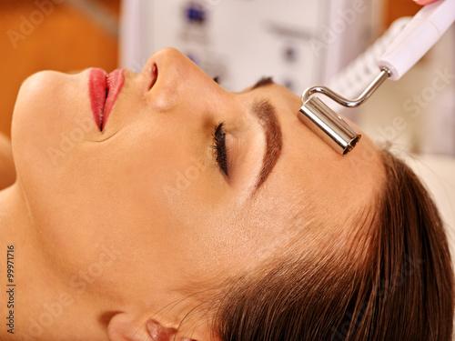 Valokuva  Young woman receiving electric galvanic facial massage at beauty salon