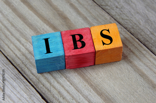 IBS text (Irritable Bowel Syndrome) on colorful wooden cubes Wallpaper Mural