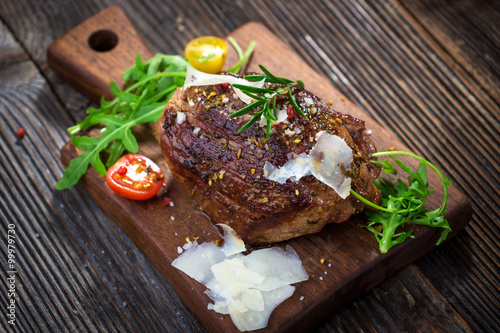 Fotografie, Tablou  Beef steak on a wooden table.