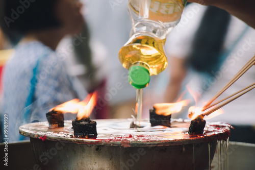 Burning Joss stick and oil palm candle at chinese shrine for