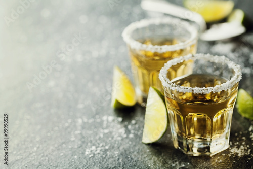 Fotografie, Obraz  Tequila shot with lime and sea salt on black table, selective focus