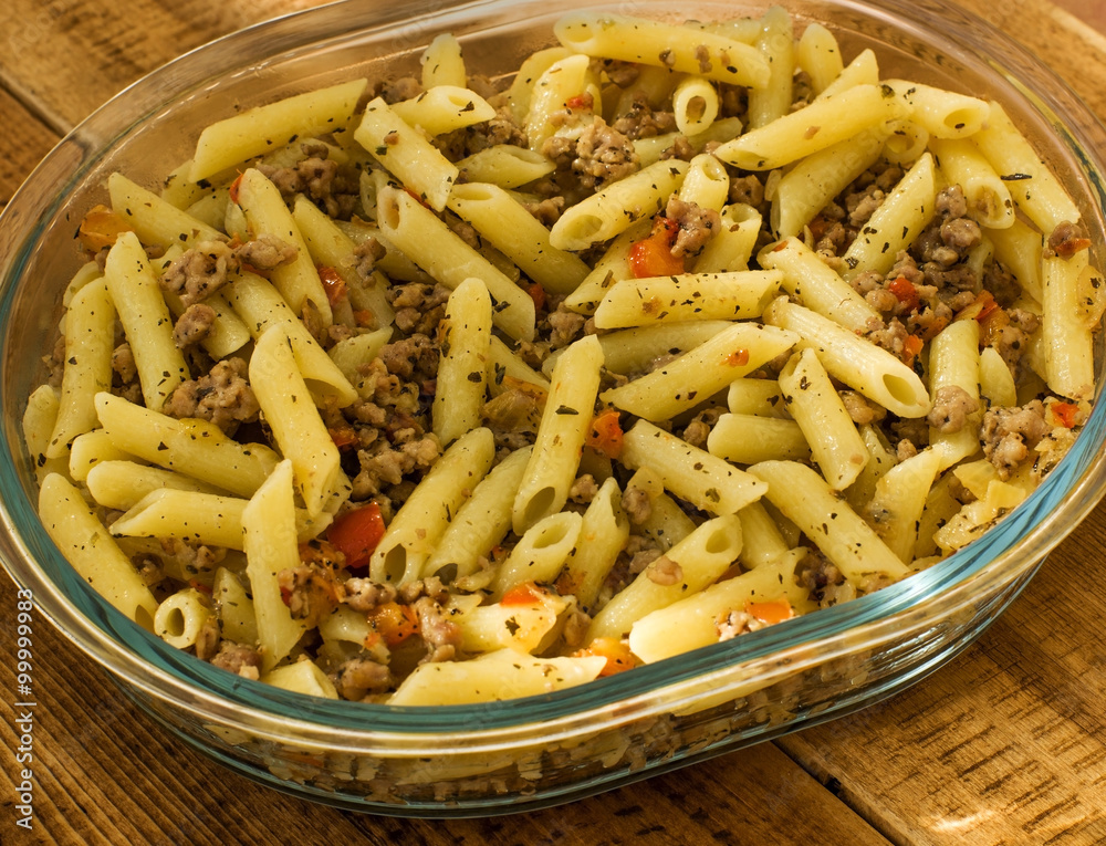 Fototapeta Minced meat with pasta onions and sweet peppers. Warm color balance.