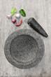 Leinwandbild Motiv Stone mortar with many kind of herbs in kitchen