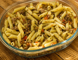 Minced meat with pasta onions and sweet peppers. Warm color balance.