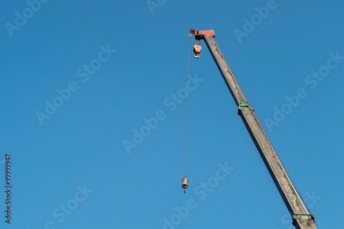 yellow crane with blue sky background
