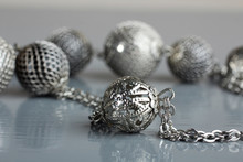Silver Decorations On A Gray T...