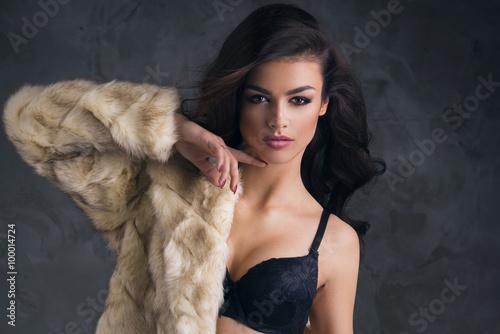 Canvas Prints Dragons Portrait of sexy brunette woman wear fur