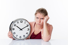 Time Concept - Complaining Beautiful Young Blond Woman Holding A Clock Unhappy And Frustrated By Future, White Background