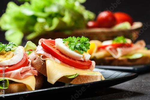 Recess Fitting Snack Delicious sandwich with prosciutto ham, cheese, tomato and egg