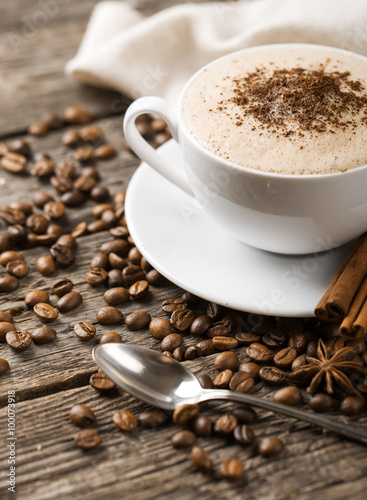 Foto op Canvas Cafe Hot coffee and pastries on a wooden background
