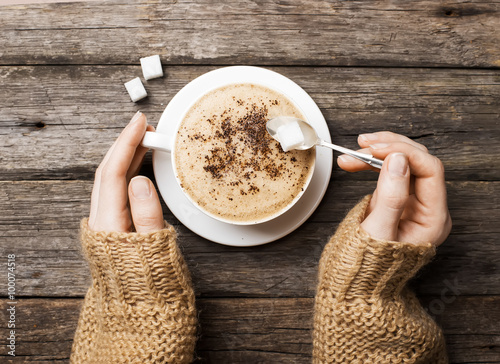 Wall Murals Cafe woman holding hot cup of coffee