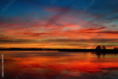Foto op Canvas Baksteen Colorful sunrise on a lake