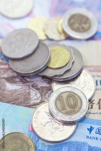 Stack of Hong kong dollar coin on bank note Poster