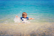 Adorable kid having fun on summer vacation, playing in the sea, image taken in Tropea, Calabria, Italy