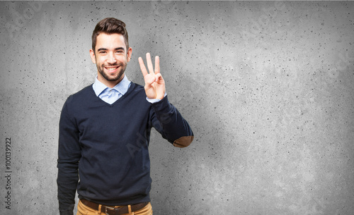 man showing number three Canvas Print