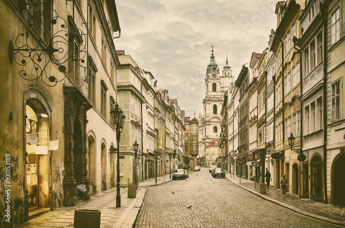 Fotomural  View to the street in the old center of Prague - the capital and largest city of