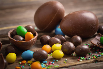 FototapetaChocolate Easter Eggs Over Wooden Background