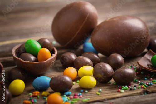 Chocolate Easter Eggs Over Wooden Background - 100172941