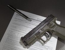 Handgun And Paperwork