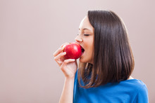 Young Woman Is Eating An Apple. Healthy Nutrition.