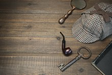 Sherlock Holmes Concept. Private Detective Tools On The Wood Tab