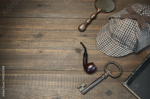 Photo Sherlock Holmes Concept. Private Detective Tools On The Wood Tab