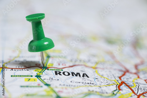 Photo  Pin indicates the destination on the road map - Roma (Italy)