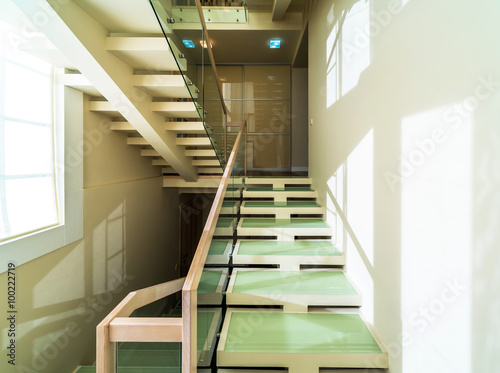 Foto op Plexiglas Trappen Glass and wooden stairs in modern home interior